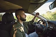 Man driving car - RAEF001357