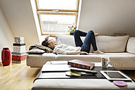 Relaxed woman lying on couch - PESF000248