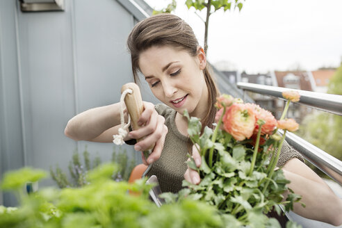 Young woman gardening on balcony - PESF000263