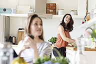 Two happy women in kitchen - PESF000329