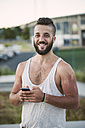 Portrait of smiling man with beard and shaved head - RAEF001393