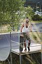 Smiling skateboarder in a skatepark - RAEF001396