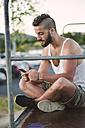 Man text messaging - RAEF001399