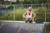 Portrait of skateboarder at skatepark - RAEF001402
