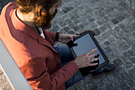 Young man using tablet in the city - MAUF000742