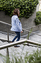 Stylish businessman walking on stairs outdoors - MAUF000772