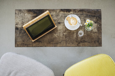 Digital tablet and cup of coffee on table in a cafe - KNSF000217