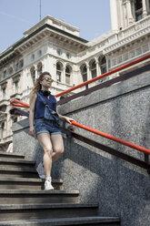 Italy, Milan, woman walking downstairs - MAUF000797