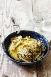 Polenta with caramelized fennel in bowl - EVGF003028