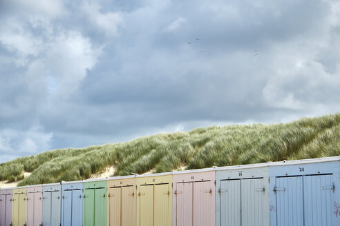 Netherlands, Zeeland, Domburg, colorful beach huts at beach - BSCF000537
