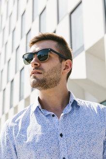 Portrait of businessman wearing sunglasses - BOYF000520