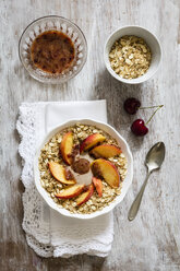 Cherry smoothie bowl with peach and oat flakes, topping - EVGF003045