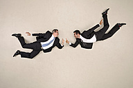 Two flying businessmen with thumps up - BAEF001163