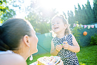 Mother and her little daughter having fun in the garden - HAPF000775