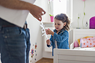 Father and daughter decorating children's room - DIGF000973