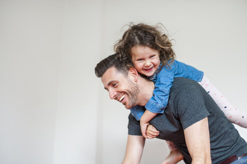 Happy father carrying daughter piggyback - DIGF000979
