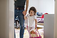 Father with daughter pushing doll buggy at home - DIGF000994