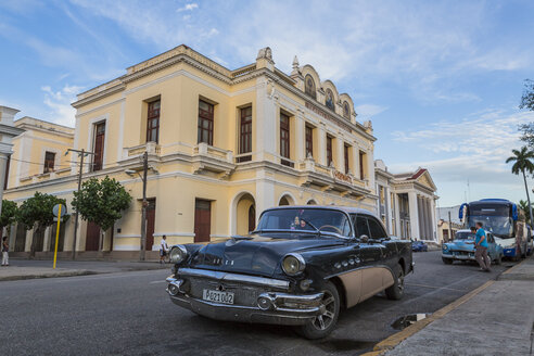 Cuba, Cienfuegos, parking American vintage car with Tomas Terry Theatre in the background - MAB000382