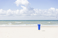 Empty beach with blue waste bin - CHPF000282