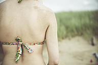 Back of woman on the beach, partial view - CHPF000288