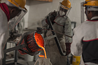 Workers casting metal in a foundry - ZEF009482