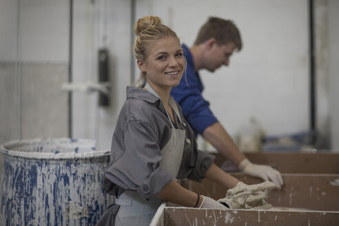 Smiling woman and man working with casts - ZEF009491