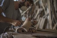 Carpenter using wood sander - ZEF009523