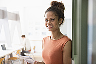 Portrait of smiling woman in office - RBF004947