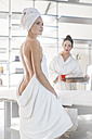 Young woman wrapped in towel in spa - ZEF009547