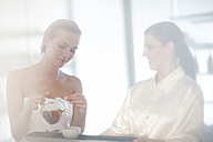 Two women in spa having tea - ZEF009577