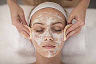 Young woman in spa receiving facial mask - ZEF009583