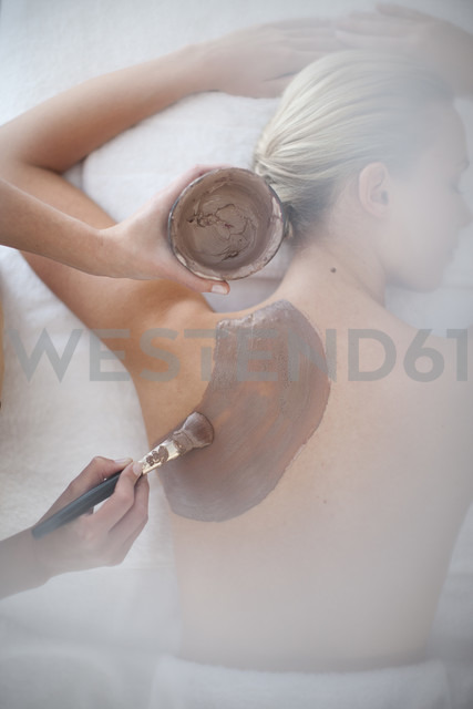 Young woman receiving chocolate treatment at spa - ZEF009592