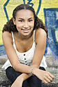 Portrait of smiling teenage girl wearing top - OJF000160