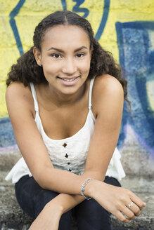 Portrait of smiling teenage girl wearing top - OJF000160