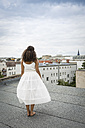Back view of young ballet dancer standing on a roof top - OJF000169