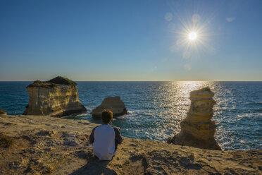 Italy, Apulia, Salento, Faraglioni of Torre Sant'Andrea, tourist watching sunrise - LOMF000339