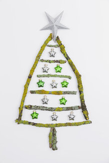Christmas tree shaped of mossy branches and Christmas decoration - GWF004880
