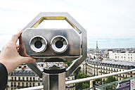 France, Paris, binoculars with the city and the Eiffel Tower in the background - GEMF000964