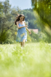Young woman, blue dress, on meadow - MAEF011937