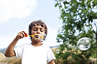 Little boy blowing soap bubbles - VABF000754