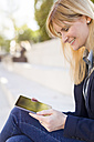 Smiling businesswoman with mini tablet - NAF000026