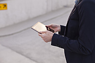 Businesswoman with mini tablet, partial view - NAF000047