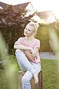 Portrait of blond woman in garden - SHKF000671