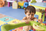 Baby boy playing in children's room - JASF001102