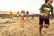 Kids playing on the beach at sunset - MGOF002316