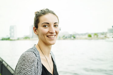 Portrait of smiling woman at riverside - TAMF000570
