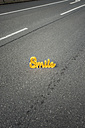 The word 'Smile' on empty street - KNSF000435