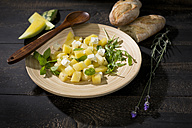 Melon salad, yellow watermelon, feta, mint and rocket on plate - MAEF011959