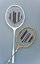 Two old upcycled badminton rackets on grey ground - GISF000236