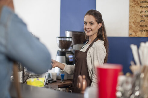 Portrait of smiling young female barista - ZEF009845